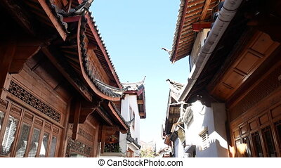 Little street with Chinese traditional houses in the old town of Lijiang, Yunnan, China.