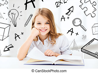 little student girl studying at school - education and...