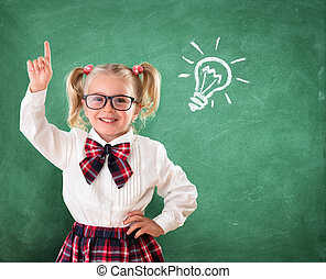 Little Student With Idea In Classroom