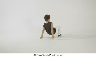 Little Stylish Boy Break Dancing And Having Fun, Isolated On WhiteStudio Shot