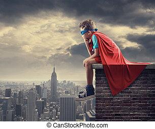 A young boy dreams of becoming a superhero.
