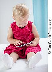 Little sweet girl using smartphone