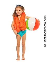 Little swimmer standing with colored wind-ball