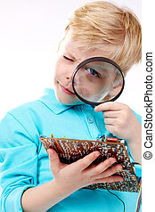 Little technician - Little blond guy holding motherboard and...