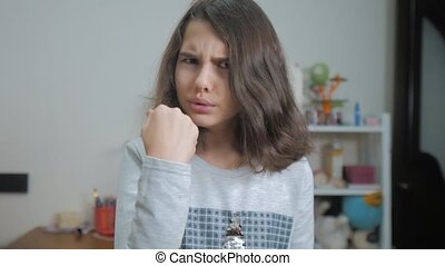 little teenage girl angry gesture fist threat. slow motion...