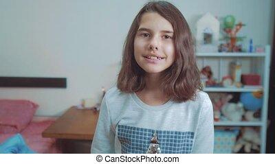 little teenage girl gesture finger quiet. slow motion video....