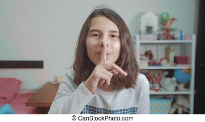little teenage girl gesture finger quiet. slow motion video....