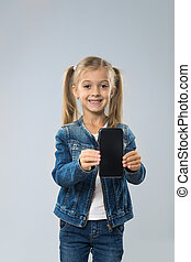 Little Teenage Girl Show Cell Smart Phone Screen With Empty...