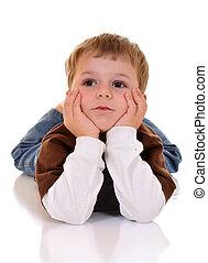 Little Thinker - Preschool boy on the floor, thinking with...
