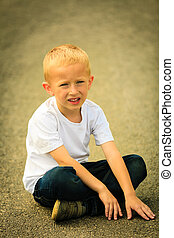 Little thoughtful boy child portrait outdoor