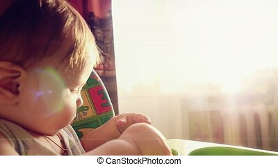 Little toddler boy playing with toy car at sunny rays in slowmotion. 1920x1080