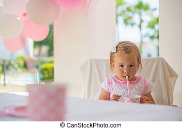 Little Toddler Drinking Juice From Paper Cup