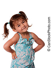 Cute little young toddler girl with attitude smirk, hands on hips and pigtails in hair, isolated.