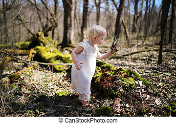 Little Toddler Girl Exploring Nature in the Woods