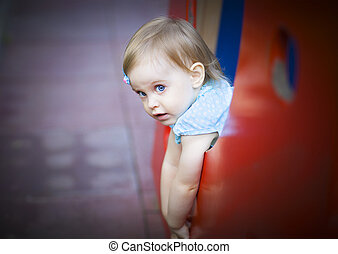 Little toddler girl on the playground