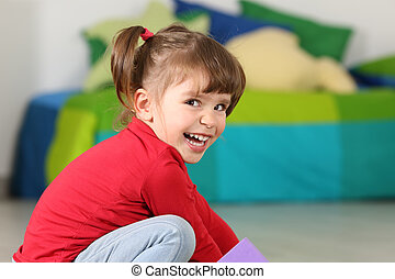 Little toddler girl smiling and looking at camera