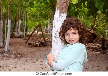 Little tourist girl posing in Mayan Riviera Jungle Mexico