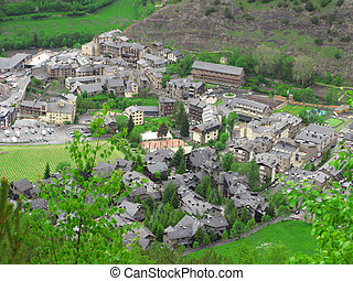 A village into a pyrenees valley, between mountains and sorrounded by green