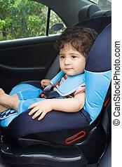 little traveller - a little traveller in his car seat ready...