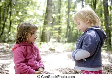 Little two sister girls in the beech forest