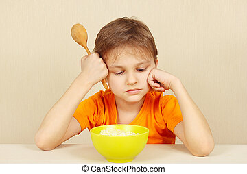 Little unhappy boy does not want to eat cereal - Little ...