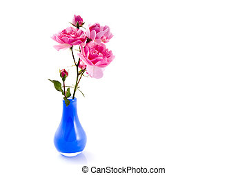 Little blue vase with pink roses