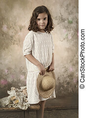 Sweet victorian girl posing in the old style