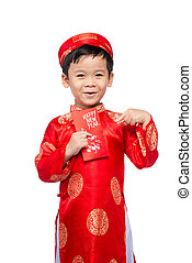 Little Vietnamese boy holding red envelops for Tet. The word mean double happiness. It is the gift in lunar new year or Tet Holiday on red isolate background.