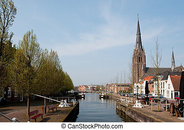 Little village Weesp with sluice in Holland