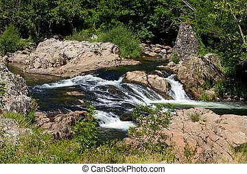 Little waterfall in the river