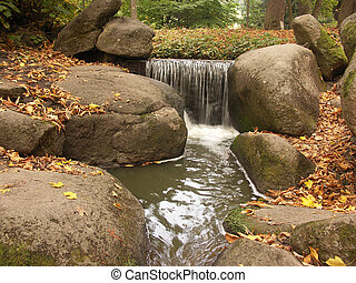 Little waterfall - Small waterfall at autumn Uman park at ...
