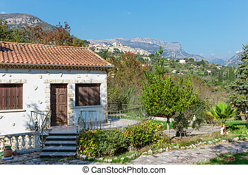 Little white house with a slate roof in Provence, France