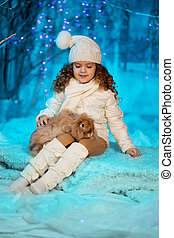 Little winter girl with rabbit