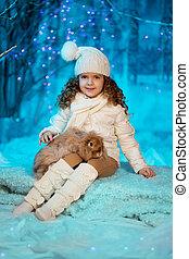 Little winter girl with rabbit