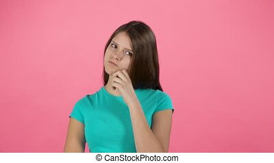 Little woman is thinking in studio on pink background. Slow...