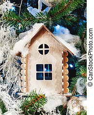 Little wooden house, decoration for Christmas tree. Traditional decoration for New Year celebration.