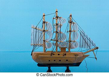 Little wooden model sailboat