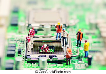 Little workers repairing motherboard. Technology concept