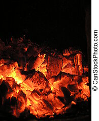 live coals in the oven against black background