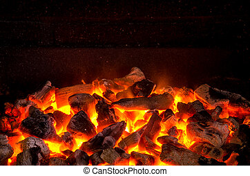 Live Coals - Photo of hot sparking live-coals burning in a...