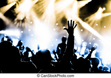 live concert - crowd cheering and hands raised at a live...
