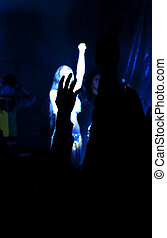 Live Concert - People in the concert. Hand of a person on a...