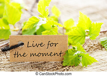 Natural Looking Label with the Quote Live For The Moment