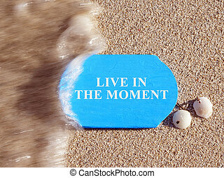 Live in the Moment inscription on a blue plate.