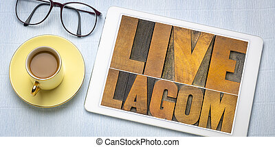 live lagom word abstract in wood type