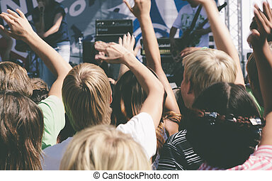 live music festival, selective focus - hands of crowd on the...
