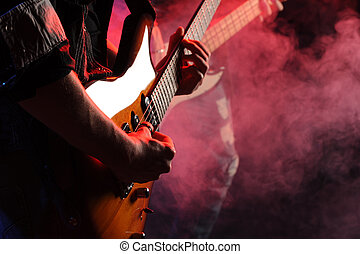 live rock - rock musicians playing at a live concert