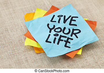 live your life - spiritual reminder - handwriting on a blue sticky note against canvas