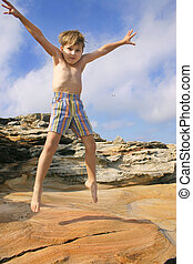 Liveliness - Boy burns off energy star jumps