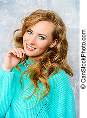 liveliness - Cheerful pretty woman in a bright casual...